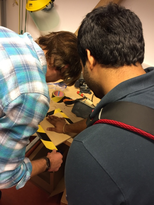 Alex and Rishi putting the finishing touches on the desktop panel.
